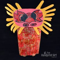 paper-bag-chinese-dragon-puppet-made-with-handprints
